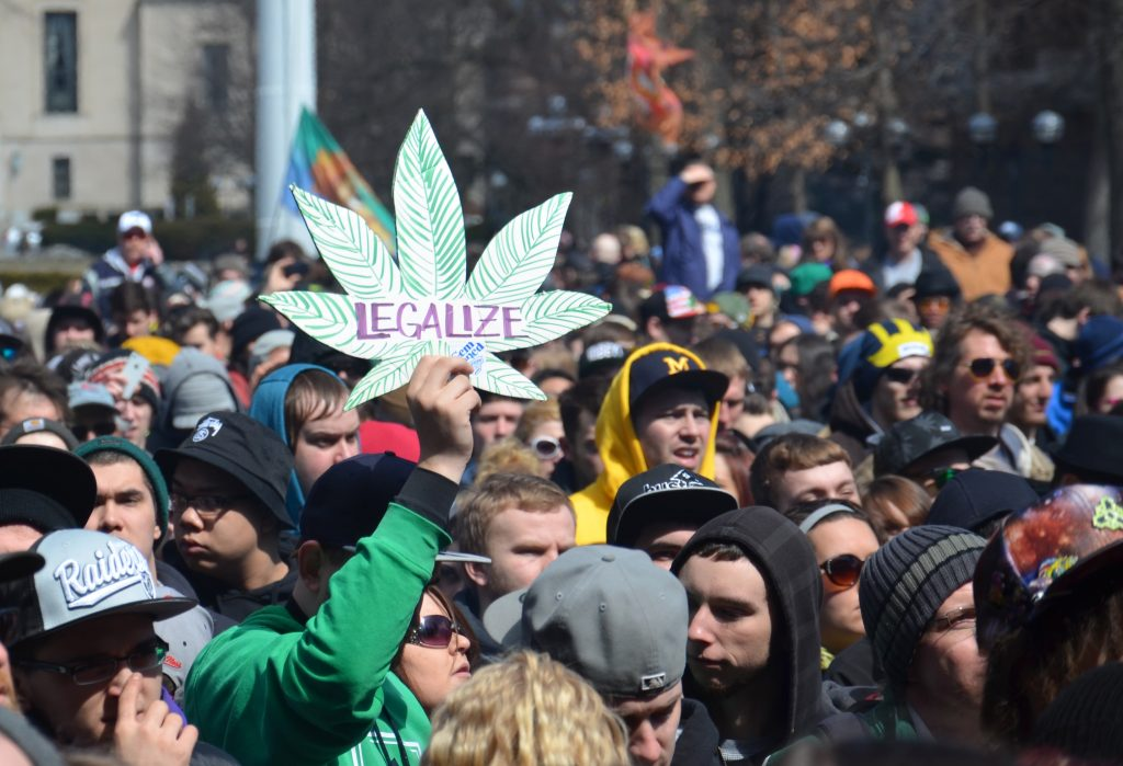 A participant holds up a sign at the 43rd annual Hash Bash in Ann Arbor, April 5, 2014.