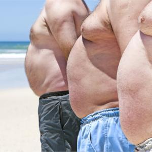 fat men on the beach