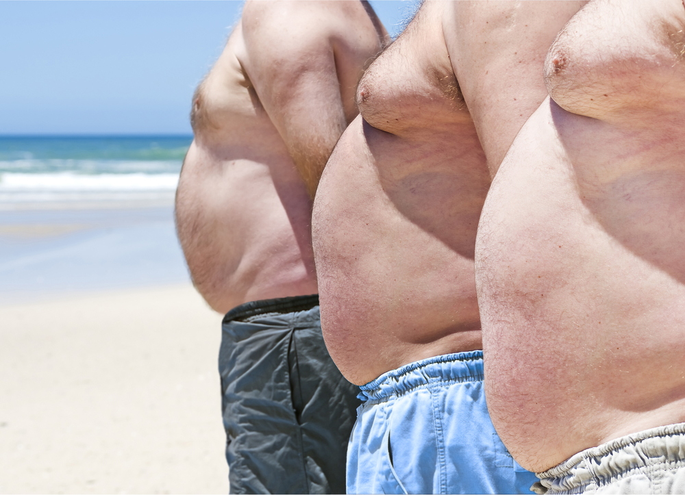 fat men on the beach